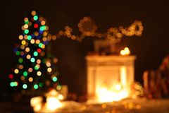 Blurred view of stylish living room interior with Christmas lights. At night royalty free stock photos