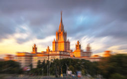 Blurred view of sunset Moscow university under cloudy sky. Radial blurred view of sunset Moscow university under cloudy sky Stock Photo