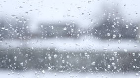 Blurred view from the window with raindrops stock video footage
