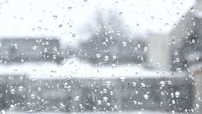Blurred view from the window with raindrops stock footage