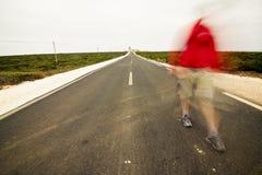 Blurred walking man Stock Images
