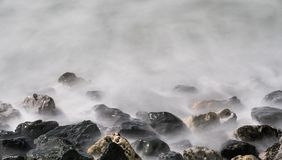 Blurred Water Over Rocks stock photography