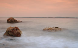 Blurred water and rocks. Rough sea photographed with a slow shutter speed to create blurred efffect Royalty Free Stock Images