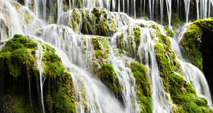 Blurred Waters of a Waterfall and Green Moss Royalty Free Stock Photos