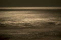 Blurred waves in the moonlight Stock Photography