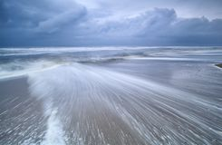 Blurred waves on stormy sea coast Royalty Free Stock Photos