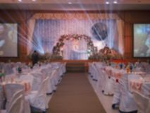 Blurred wedding hotel with flower, carpet walkway and table for background stock photos