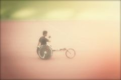 Blurred wheelchair Stock Images