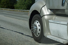 Blurred wheels of truck Stock Photo