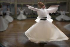 Blurred Whirling Dervishes practice their dance Royalty Free Stock Photo