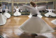 Blurred Whirling Dervishes practice their dance Stock Image