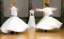 Blurred Whirling Dervishes practice their dance. In Istanbul, Turkey on Apr 30, 2016 Stock Photos