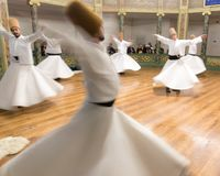 Blurred Whirling Dervishes practice their dance Royalty Free Stock Photography