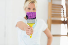 Blurred woman holding paint brush at new house Royalty Free Stock Image
