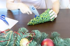 Blurred woman`s hand making diy christmas decor stock photos