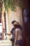 Blurred woman using on the camera Stock Images