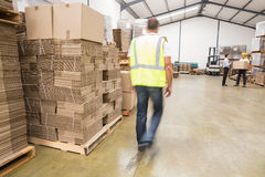 Blurred worker walking in warehouse Royalty Free Stock Photo