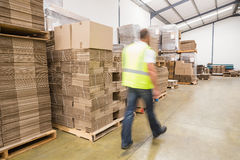 Blurred worker walking in warehouse Stock Photography
