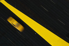 Blurred yellow taxi Stock Images