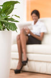 Blurred young black girl with laptop computer. Stock Photography