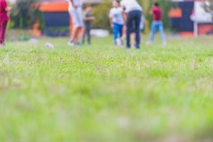 Blurred young children football players running in park royalty free stock photo