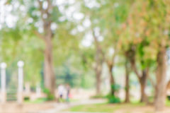 Blurred young couple walking in the park Stock Photo