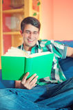 Blurred young man with glasses and book Stock Images