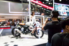 Blurred of young pretty model with motorcycle in moto Stock Images