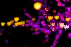 Blurring lights bokeh background. Of pink, red, orange, yellow, purple hearts royalty free illustration