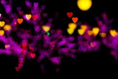 Blurring lights heart. Blurring lights bokeh background of pink, red, orange, yellow, purple hearts vector illustration