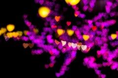 Blurring lights heart. Blurring lights bokeh background of pink, red, orange, yellow, purple hearts stock illustration