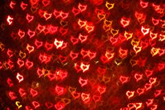 Blurring lights bokeh background of Devil hearts. Blurring lights bokeh background of red Devil hearts Stock Image