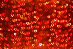 Blurring lights bokeh background of Devil hearts. Blurring lights bokeh background of red Devil hearts Stock Photo