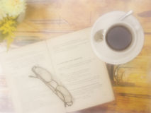 Blurring smoke Book with coffee on vintage style Stock Photography