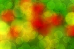 Blurred abstract background bokeh. Blurry abstract background with bokeh effect, poppies in the grass Royalty Free Stock Photo
