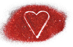 Blurry abstract background with heart of red glitter sparkle on white surface Stock Images