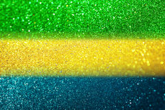 Blurry abstract glitter lights background using brazil flag colo Royalty Free Stock Photo