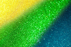 Blurry abstract glitter lights background using brazil flag colo Stock Images