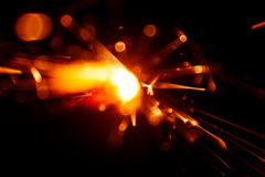 Blurry, abstract style decorative sparkles. From a sparkler candle Royalty Free Stock Image