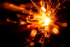 Blurry, abstract style decorative sparkles. From a sparkler candle Royalty Free Stock Photos