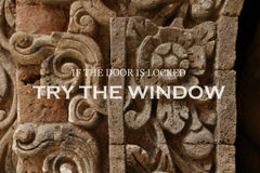 Blurry ancient wall with Inspirational quote - If the door is locked try the window. Blurry balinese ancient wall with Inspirational quote for background or wall Royalty Free Stock Photo