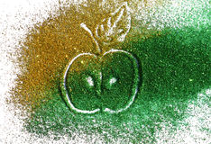 Blurry apple of golden and green glitter sparkle on white background Royalty Free Stock Images