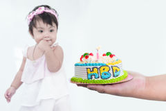 Blurry Asian girl and selective focus at happy birthday cake on. Hand royalty free stock image