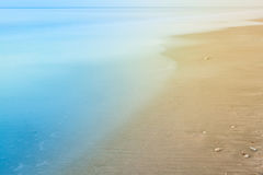 Blurry background of beach and sea waves with vintage color. Blurry background of beach and sea waves with vintage color style stock photography