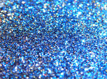 Blurry background of blue, black, golden and red glitter sparkle Royalty Free Stock Photography