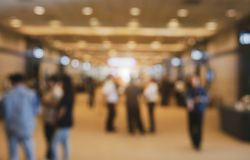 Blurry background of exhibition expo with crowd people in convention hall. Abstract concept. Business marketing and event theme. stock image