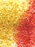 Blurry background of golden and red glitter sparkle Royalty Free Stock Photo