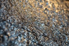 Blurry background. Gradient with dark silver crumpled foil royalty free stock photography