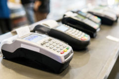 Blurry Background of Many Credit card machines placed in the store. These machines are customers required loan products in the mal Royalty Free Stock Photo