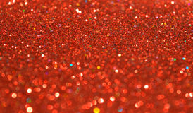 Blurry background of red glitter sparkles Stock Photography